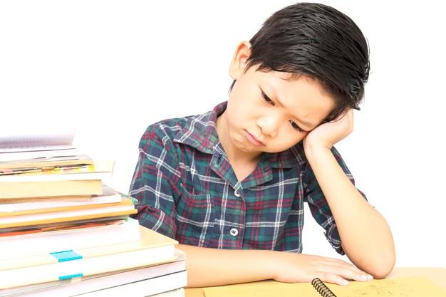 boy-is-unhappy-doing-homework_1150-6279